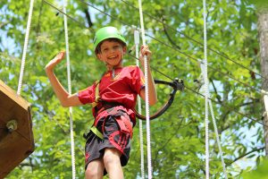 young boy on high ropes course