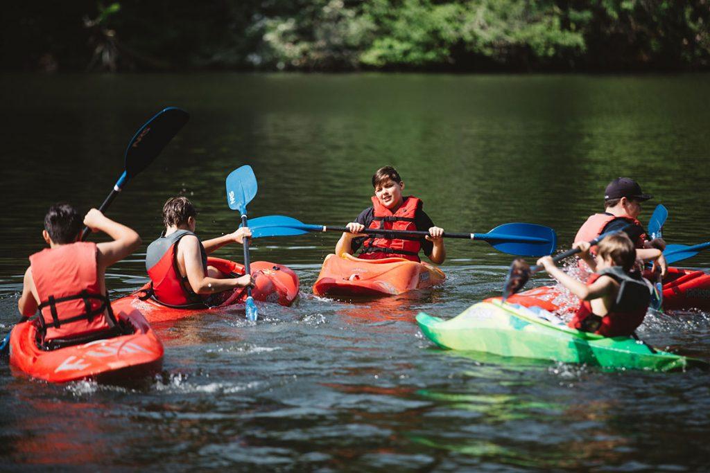 boys kayaking in lake